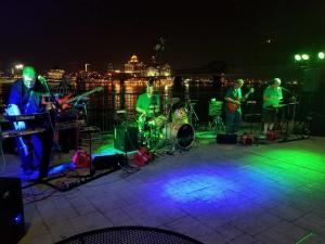Band Playing In Front Of Colorfully Lit Dance Floor