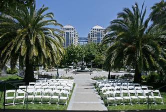Preservation Park's outdoor event venue seating between palm trees