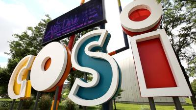 Large, colorful COSI science museum sign