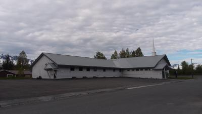 a church with a steeple in a small town