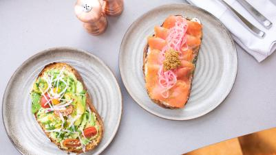 Plated smoked salmon toast and avocado toast at Flossie's in Irving
