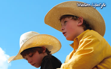 Two Kids With Cowboy Hats In Los Alamos, New Mexico