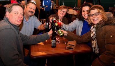 group gives a toast at zoobrew event at the Seneca Park Zoo in Rochester, NY