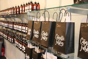 Candle Fusion gift bags hanging on hooks