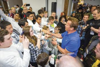 Arnold Schwarzenegger surrounded by fans at his Sports Festival
