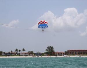 Several people parasailing far above Englewood Beach