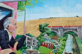 "A section of Tiffany Black's ""Open Windows"" mural on Diesel's Sports Grille in Danville"