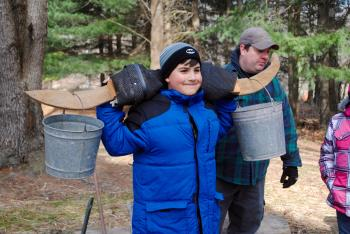 See what it's like to carry buckets of sap with a yoke during Maple Syrup Days at McCloud Nature Park. (Photo courtesy of Hendricks County Parks & Recreation)