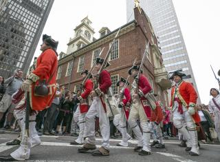 Colonial reenactors march the streets of Boston