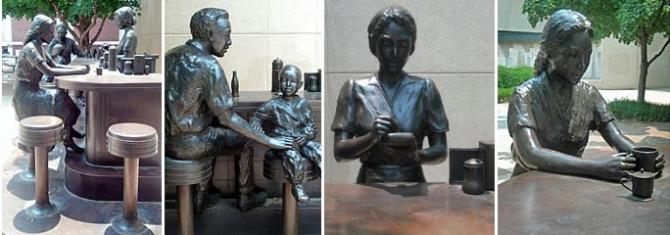 A large bronze sculpture of people sitting at a bar commemorating the 1958 anti-segregation sit-in at Dockum Drug Store's counter