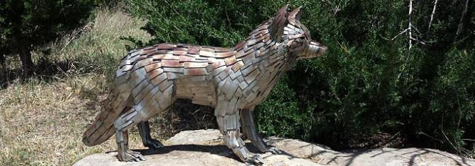 A metal fox sculpture by Randall Julian stands on a rock at Chisholm Creek Park in Wichita