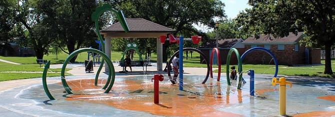 Kids play in the fountains on the splashpad at Fairmount Park