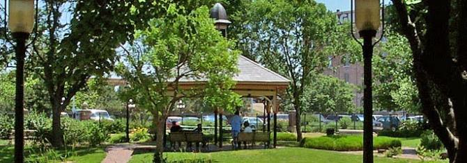 People gather under the gazebo at Naftzger Park in Wichita