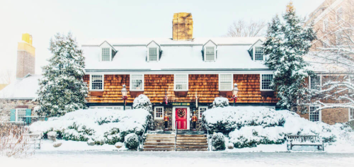 A watercolor painting of the Nassau Inn covered in snow