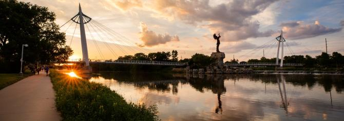 Wide angle shot of the Keeper of the Plains at dusk from the south bank of the river in Wichita