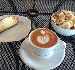 Lupa's Coffee latte with sliced banana on the side