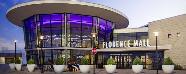 Florence Mall exterior with sign and potted landscaping.  Located in Florence, Ky.