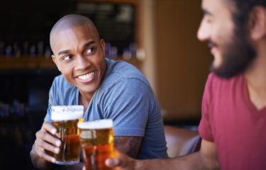 Men Drinking Beer - Stock