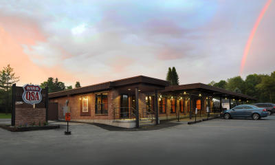 Exterior shot of PJ's BAR-B-QSA during sunset