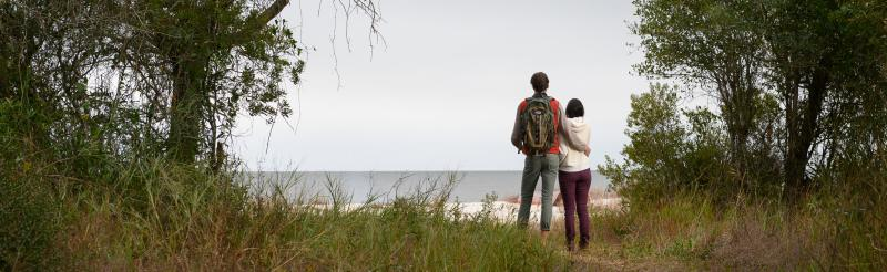Couple hiking on island