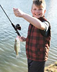 Young Boy With a Fish