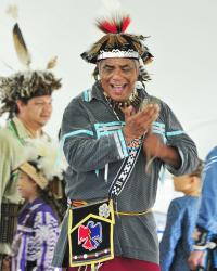 A man participates in the Native American Dance Festival at Ganondagan