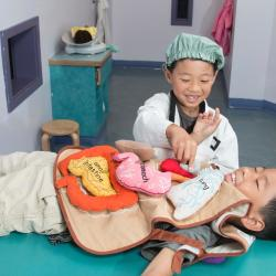 Children playing doctor and patient at Pretend City Children's Museum