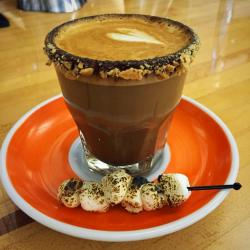 The S'mortado beverage from Roosevelt Coffee House, served with a cracker crumble rim and toasted marshmallows