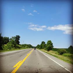 Open road with bright blue sky