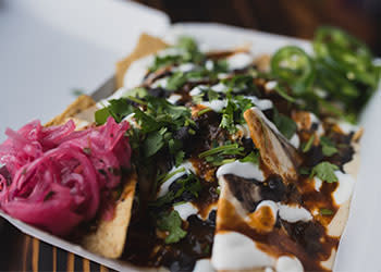 Black Bean Tricked Out Nacho - Photo Courtesy of Lloyd Taco Factory