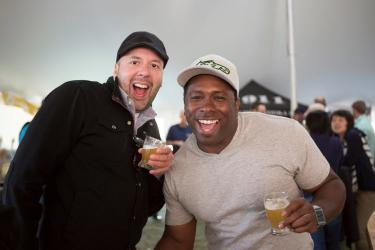 Two men enjoy tastings at the Beer Garden at the Rochester Lilac Festival