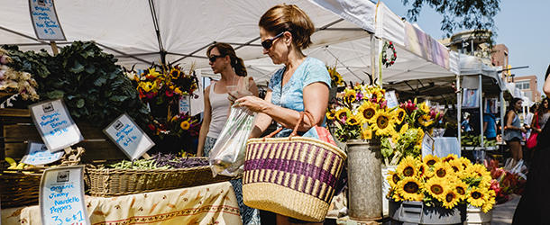 Two women shopping at Boulder Farmers' Market