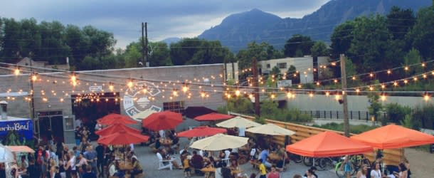People dine on patio at the Rayback Collective in Boulder