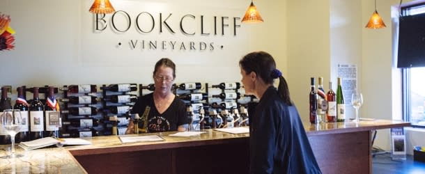 Woman Tasting Wine at Bookcliff Vineyards