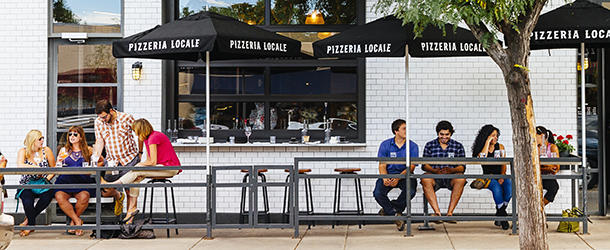 People sitting on the outside patio of Pizzeria Locale