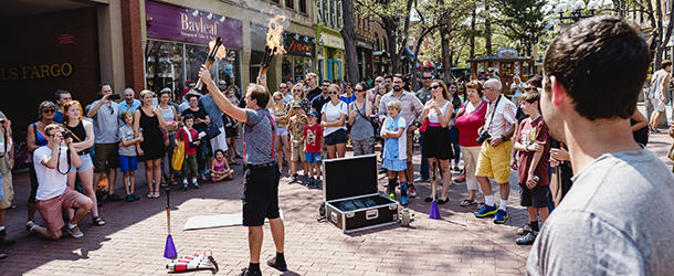 Crowd surrounding Pearl Street Performer