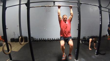 CrossFit athlete performing bar exercises.