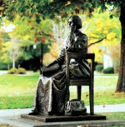 A bronze statue of Susan B. Anthony sits out front of the Ontario County Courthouse