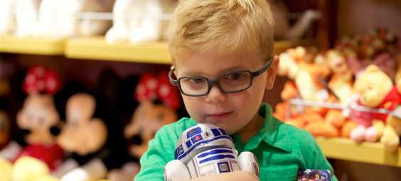overland park disney store boy shopping