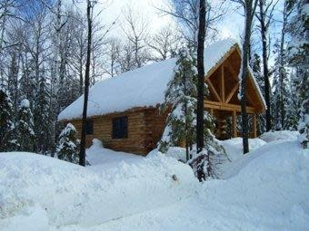 Snow covered log cabin