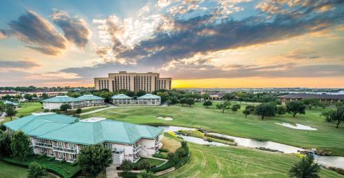 An aerial photograph of the Four Seasons Resort Dallas at Las Colinas.