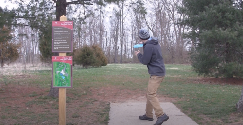 Man Playing Disk Golf At Indian Riffle Park In Kettering, OH