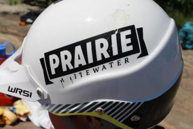 """White helmet with a """"Whitewater Kayaking"""" decal."""