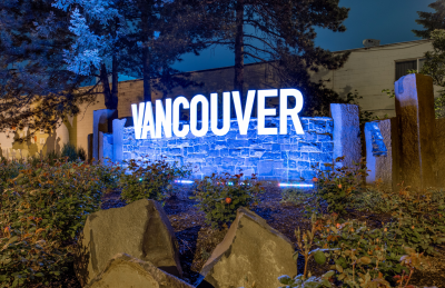 Vancouver Gateway sign lit up purple