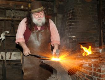 A blacksmith hard at work in Old Cowtown