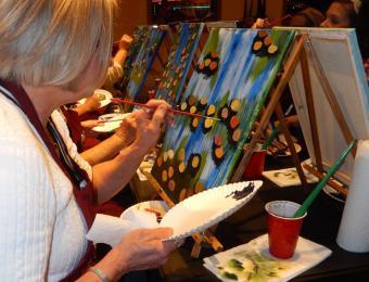 Lady painting oranges