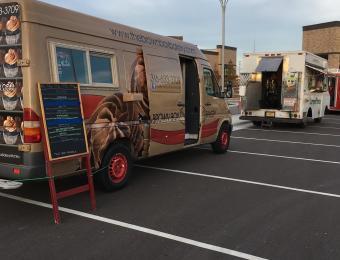 Brown Box truck open Visit Wichita