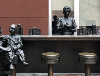 Dockum Sit-in Bronze Statue