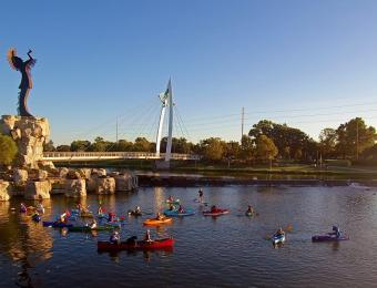 kayaks on the arkansas river near the keeper of the plains in wichita