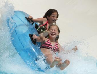 Two Girls Exiting a Waterslide at Rock River Rapids